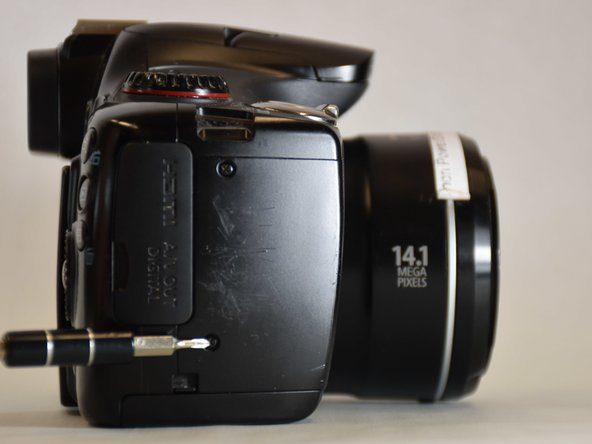 Position the camera so that the right side is visible as shown.