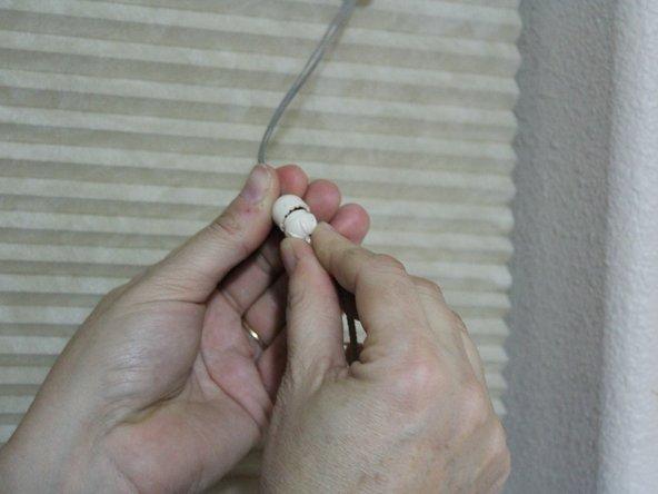 Screw the lower half of the tassel onto the top half.