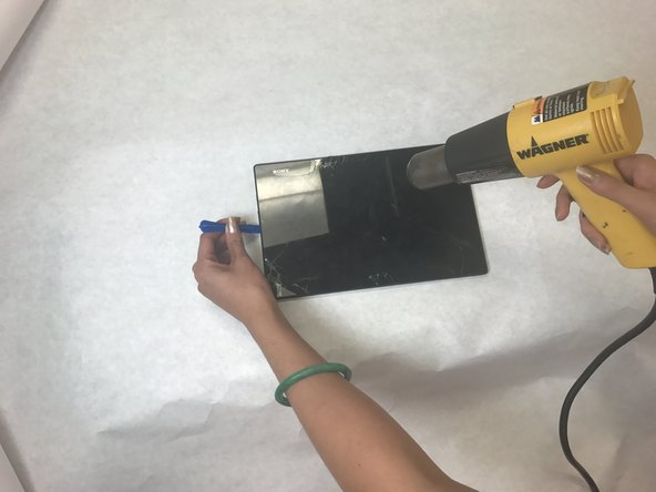 Use a hairdryer, heat gun, or something suitable to heat the edge of the screen to soften the adhesive holding the screen.