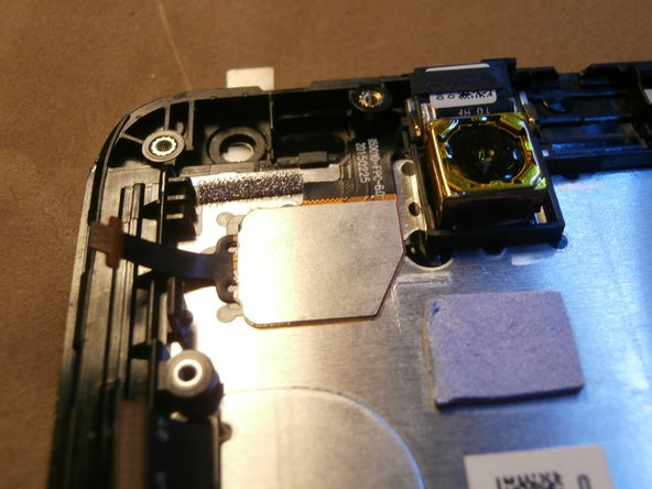 Insert the new screen into position by passing the flat into the specific grooves