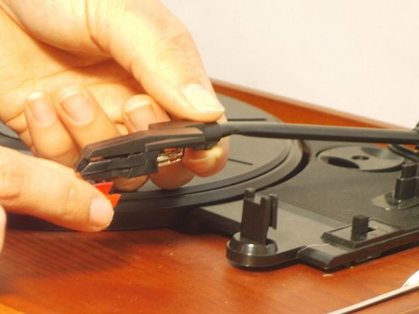 With steady hands, gently tug the needle from its cartridge pulling downwards.