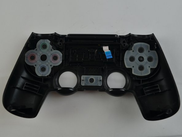 Remove the rubber pads that secure the buttons in place for the arrow buttons, shape buttons, and Playstation Home button.