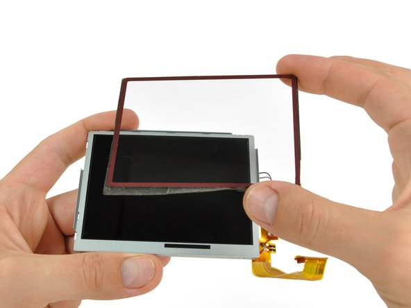 Firmly grasp the upper screen, and lifting from the right edge, pull the upper screen off of the upper LCD.