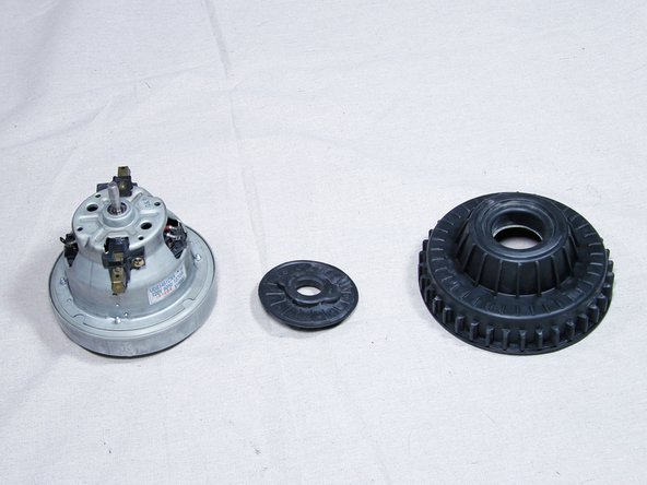 Remove the two rubber grommets from your old motor, then transfer them to your new motor.