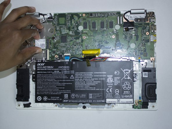 Carefully slide the wireless card out of its socket on the motherboard.