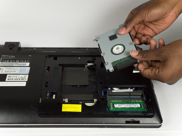 Remove the Hard Drive by lifting it towards you.