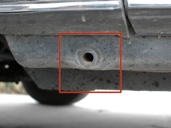 Check along the bottom edge of the car for rust; you may need to squat down low to see it.