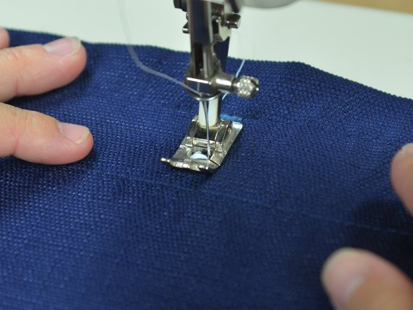Sew the bar tack at the bottom of the buttonhole.