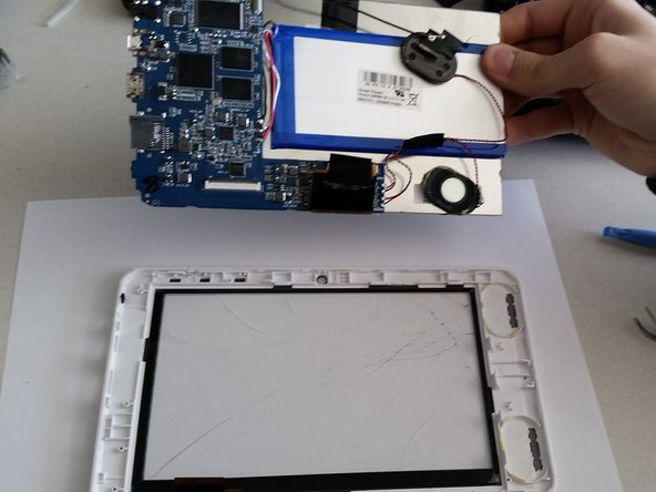 Pry under the aluminum touch screen to remove the remaining components from the front housing.
