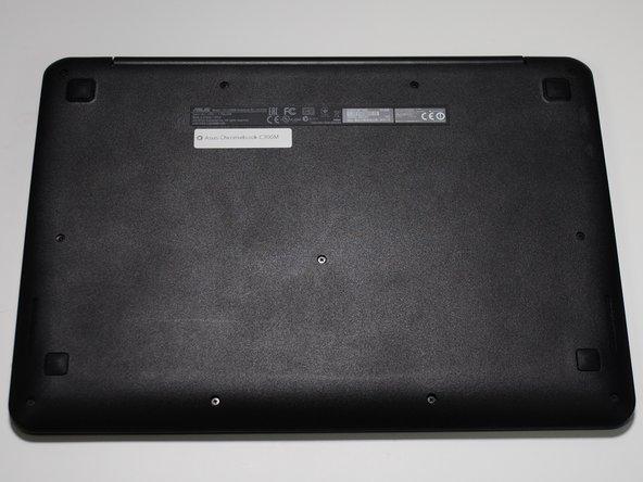 Flip the Chromebook over, bottom-side up.