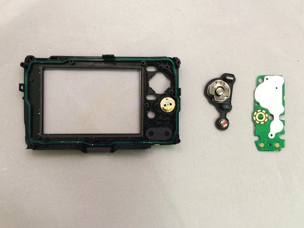 Use your fingers to lift the green circuit board and buttons out of the case.