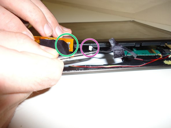 Image 2/2: Then gently pull the cable away from the tab with tweezers disconnecting the plug from the outlet. You can purchase the ifixit tweezers here [https://www.ifixit.com/Store/Tools/Tweezers/IF145-020-2]