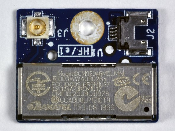 Image 3/3: Like the other Unibody machines, the Airport card is in the display assembly clutch cover.