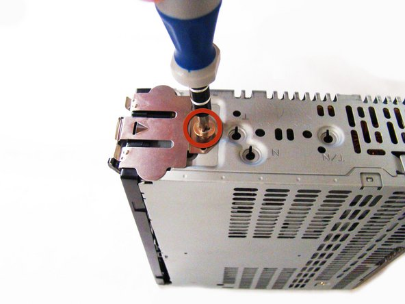 Using the Phillips #1 Screwdriver, unscrew the 2 thick screws (length - 7.69mm) located on both sides of the stereo.