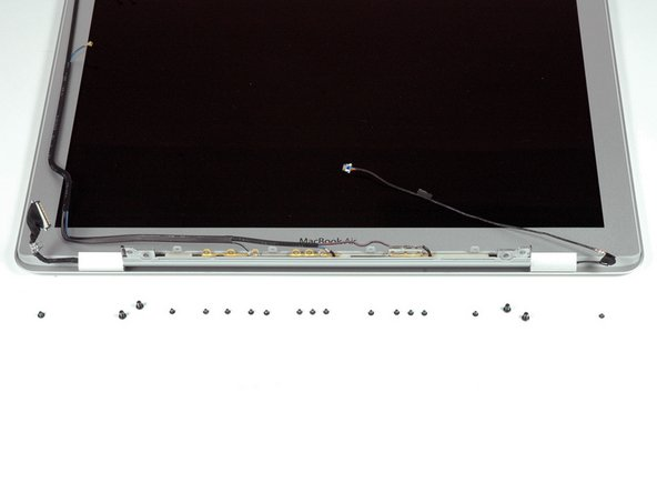 The display assembly is attached to the case with 19 small screws: