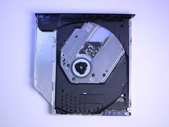 This should expose the inside of the CD drive.