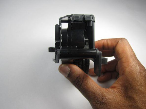 Lift up on the plastic piece to remove the entire wheel assembly.