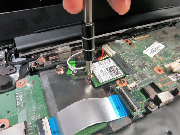Remove the 4 mm Phillips #1 screw on the Wi-Fi card.