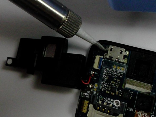 Image 1/1: Using a soldering iron, solder the connections in place.