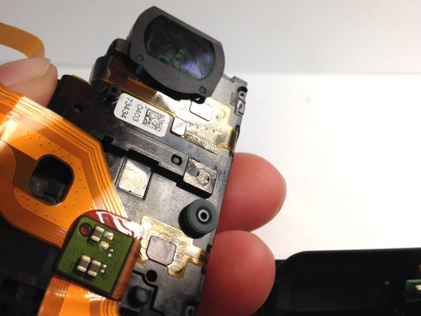Carefully remove the  black piece on the lefthand side.