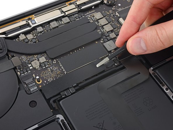 Carefully peel up the large piece of tape covering the battery connector, on the edge of the logic board nearest the battery.