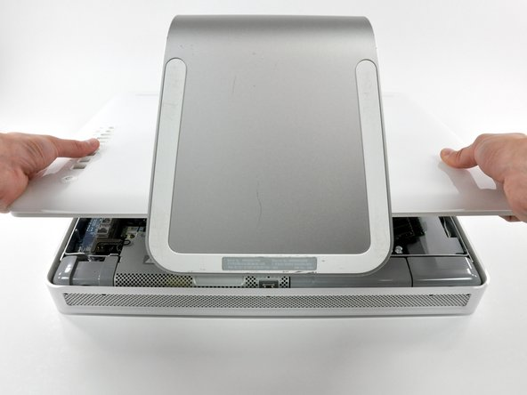 Image 2/2: Pull the rear panel toward yourself and remove it from the iMac.