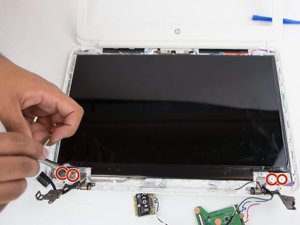 Using the Phillips #1 screwdriver, remove the (4) four screws located at the bottom of the display.