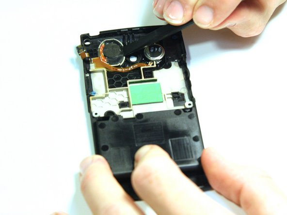 Note: The antenna is located on the back case of the phone.  Flip over the back case of the phone so that the interior is facing up.