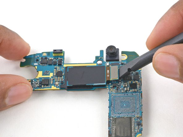 Use the flat end of a spudger to disconnect the rear-facing camera connector from its socket on the motherboard.