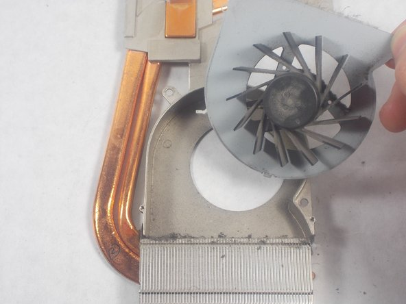 Remove the cooling fan from the heat sink assembly by pulling it upward.