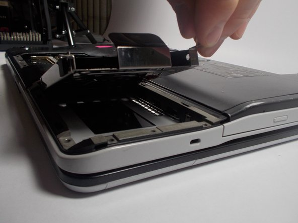 Image 1/1: When inserting new hard drive note that there is a slot on the left where the hard drive port slides into.