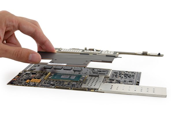 Image 2/3: The cooling system in the Surface Book bears a passing resemblance to the large copper plate tucked against the battery of the [https://www.ifixit.com/Teardown/Microsoft+Surface+Pro+4+Teardown/51568#s112628| Surface Pro 4|new_window=true], but covers ''silicon'' instead of Li-ion.