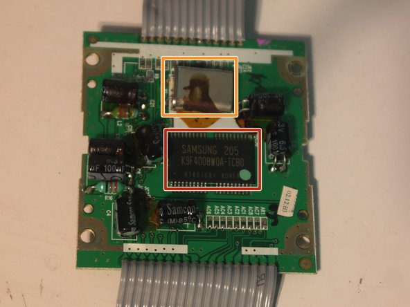 Image 2/3: Crystal oscillator, covered in the same unusual substance found on the main board.