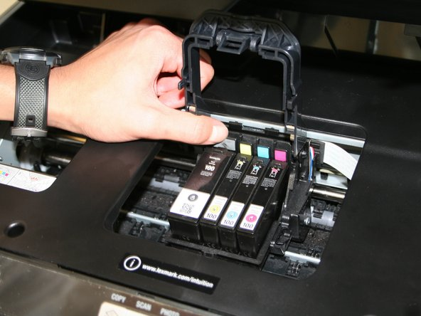 Lift the frame to expose the ink cartridges.
