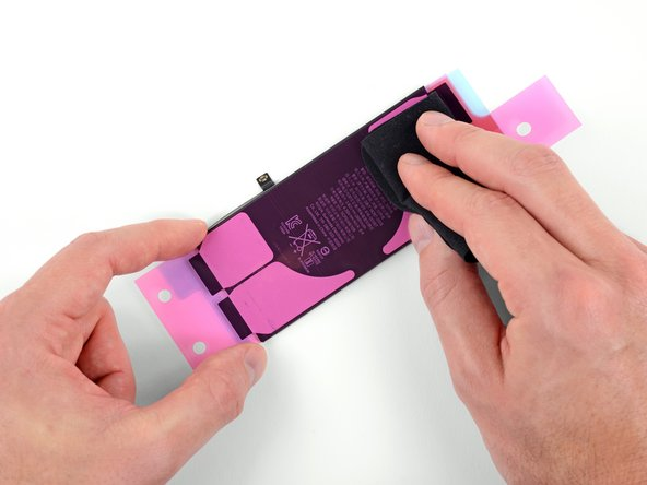 Use your fingers or a cloth to press the strips firmly into place on the battery.
