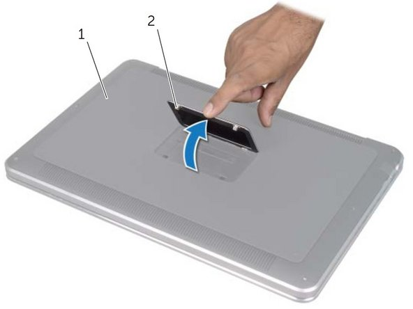 After turning off the computer, turn over the laptop and lift up the system badge (#2).