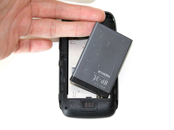 Slide the back cover off, and remove the battery