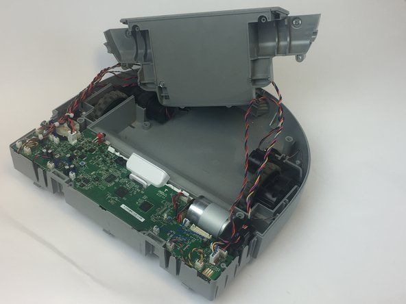 Image 1/2: Remove the wheel's wires that are attached to the motherboard.