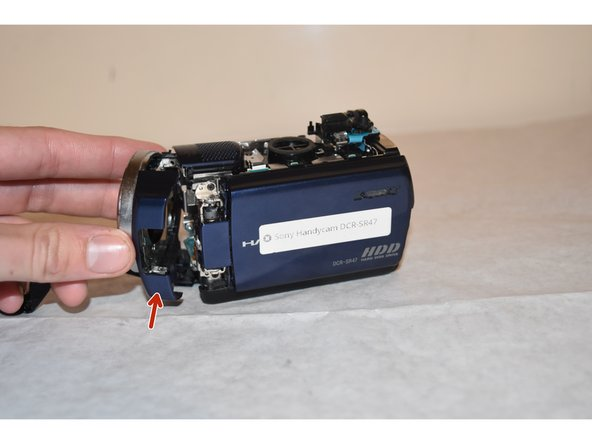 Carefully remove the lens covering from the camera in order to access the internal components