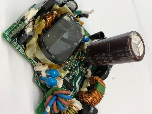 The large capacitor on the circuit board can be bent upright to show more components underneath it.