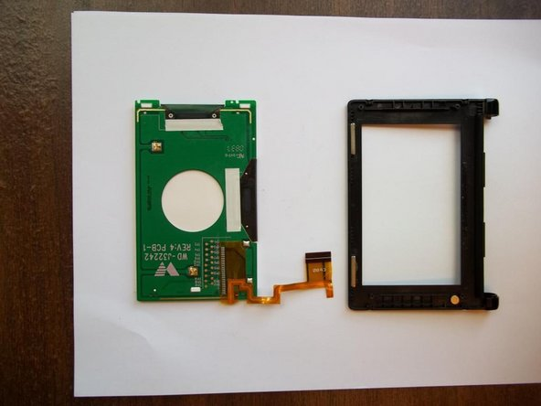 Remove screen and circuit board from the black frame with your hand; it should come easily.