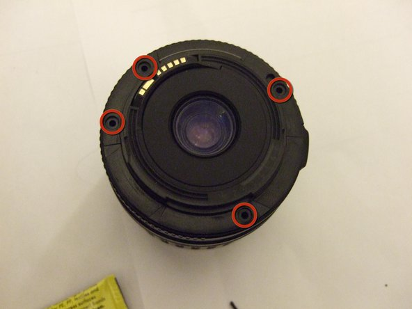 Next, remove the four screws holding the rear cover of the lens on