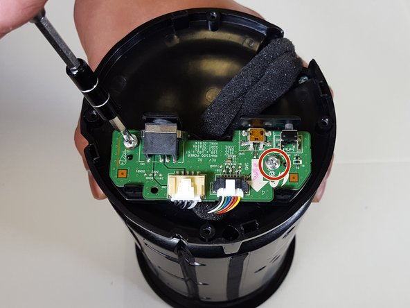 Image 1/1: With caution remove the Port Panel from the speaker body, exposing the ribbon cables.