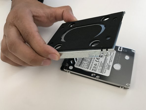 Remove hard drive from housing.