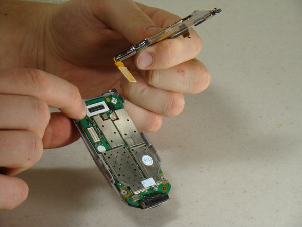 Image 3/3: Separate the keypad from the circuit board.