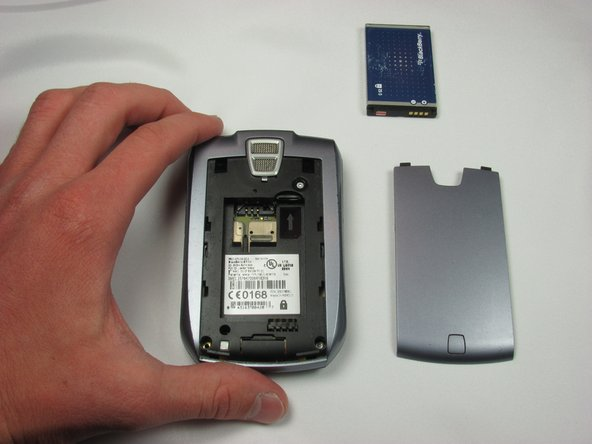Replace the battery by positioning the top of the battery in the phone and snapping in the bottom.