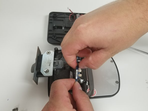 Gently unplug the actuator's connector from the circuit board.