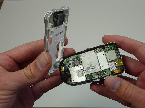 Image 2/3: Remove the SIM card located on the back of the phone.