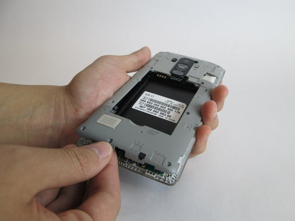 Image 2/3: Once a clip is released, you can detach the motherboard cover with your fingers and set aside.