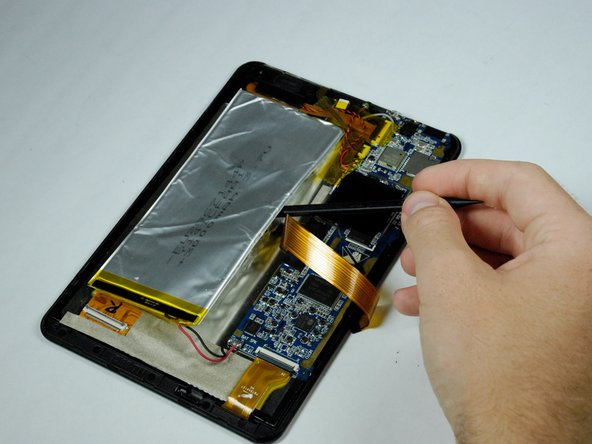 Use the spudger to gently dislodge the battery from the tablet.